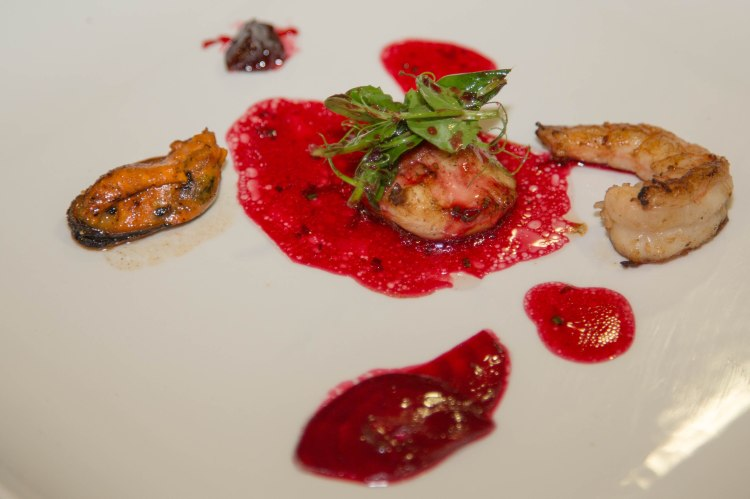 scallop prawn and muscle with beetroot Berry sauce with lemon chive dressing.